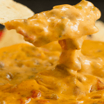 A Super Cheesy Crock Pot Spicy Beef Queso Dip